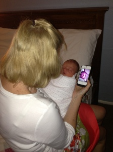 Comparing my two-day-old granddaughter with a photo of her mom at that age