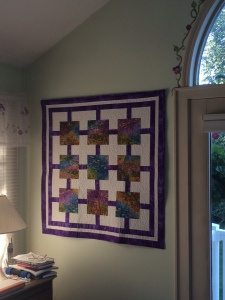 Handmade wall hanging quilted by a member of the